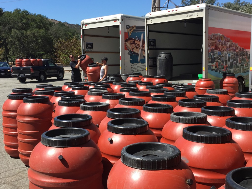 "Photos by Charly SHELTON Pre-ordered rain barrels were delivered to local residents at the Descanso Gardens ""Drought-Tolerant and Rain Barrel Event."""