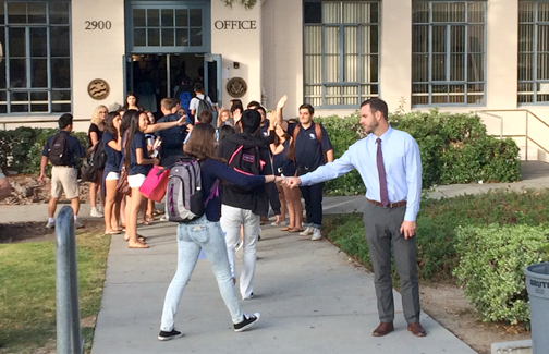 File photo Forest Holbrock (giving a fist bump to a student on the first day of school at CVHS) has left his position to become the assistant principal at Huntington Beach Isaac Sowers Middle School.