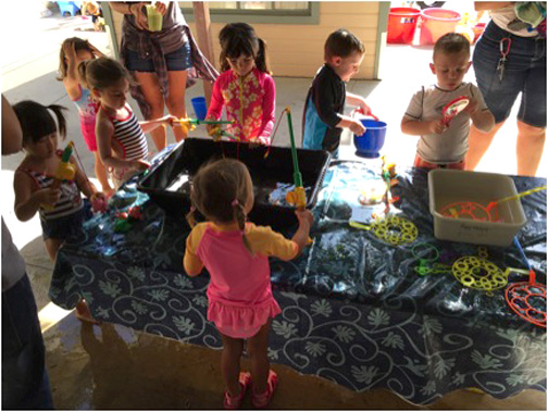 "Photo provided by CCNS CCNS Preschoolers playing with bubbles and ""fishing"" at water play day."