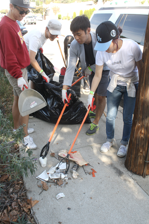Photo by Robin GOLDSWORTHY Members of Kojobs USC traveled to take part in the clean up of Foothill Boulevard on Saturday.