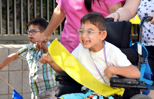 Photos by Dan HOLM Tro Kosteen races to the finish during the Walk/Wheel-a-thon held on Wednesday, Sept. 30 at College View School. Beside him is Kingston Cortez.