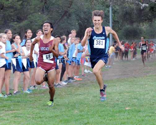 Senior Robert McNelis made a powerful effort to catch up to Arcadia Tony Segura at the finish line.