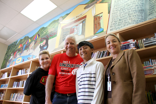 Photo by Charly SHELTON From left, Rosemont Principal Cynthia Livingston, Lincoln Elementary Principal Stephen Williams, story author Matthew Apostol and Assistant Superintendent Lynn Marso in front of the new mural.
