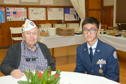 Photos by Dick CLUBB Charles Tucker, with a JROTC member, enjoyed the mixer hosted by Crescenta Valley Chamber of Commerce and the American Legion Hall on Veterans Day.