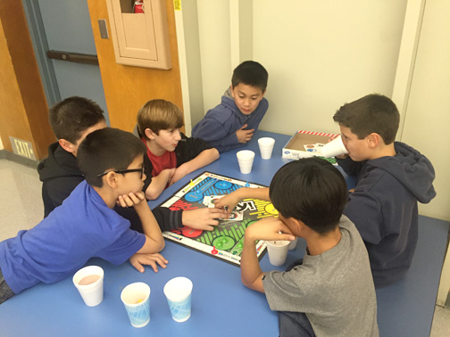 8.Boys enjoying Game Night