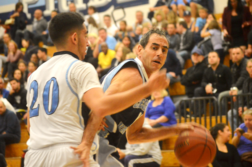 Photos by Brandon HENSLEY Greg Goorjian, guarded by Tadeh Tarverdians, looks for a shot in the Falcon alumni basketball game. Goorjian scored 14 points in the contest.