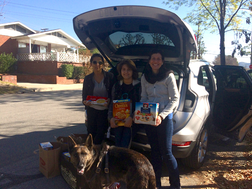Photo by Mary O'KEEFE Overseeing the donations of food and gift cards at the Twelve Oaks facility are (from left) Paris Cohen, daughter Rebecca and Joy Smith.