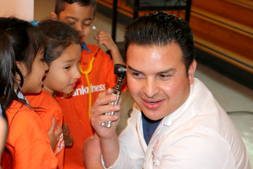 Dr. Antonio Zamorano from Dignity Health Glendale Memorial Hospital with children from Cerritos Elementary School.