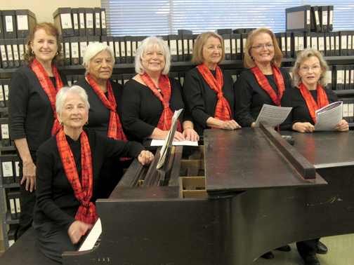 Photo courtesy of Verdugo Hills Women's Chorus Director Sharon Schlarb, seated at piano and surrounded by (from left) Marianne Jennings, Rosa Frommer, Jeanne Long, Judi Mcclure, Ginney Pruitt and Mia Lundergan.