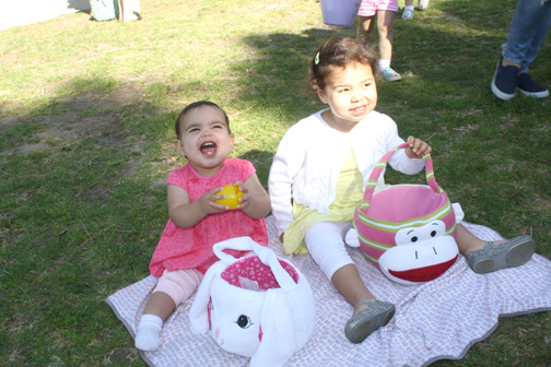 Having fun were Ivy, 10 mos., and and Ruby Levasseur, 2. years.