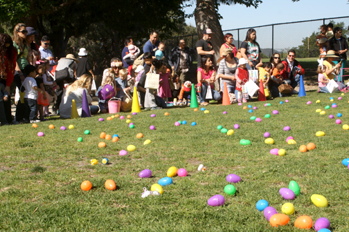 Preschoolers wait for the signal to hunt eggs.