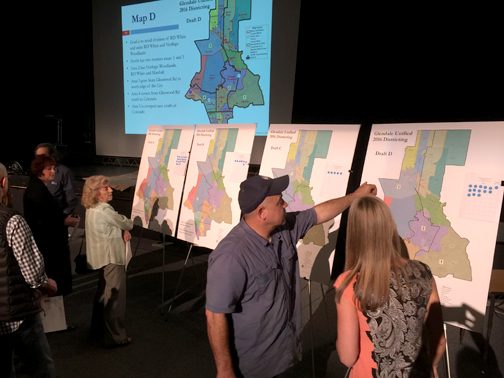 Photo by Charly SHELTON Attendees of the March 16 redistricting meeting at Crescenta Valley High School look over the options proposed to create a trustee area district.