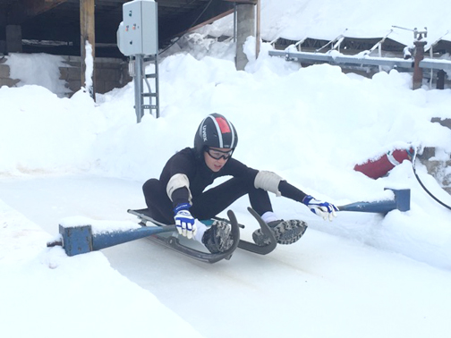 Rosemont Middle School student Jacob Petersen is an avid luge athlete. He's shown above about ready to push off.