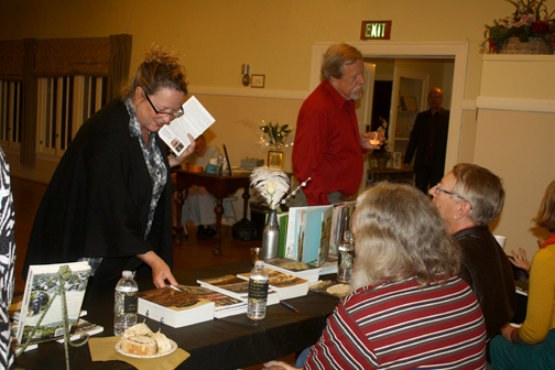 "Photos by Robin GOLDSWORTHY Former councilmember Kyle Studebaker (standing) talks with authors Mike Lawler (left) and Gary Keyes at the ""A Literary Evening"" held at the La Crescenta Woman's Club."