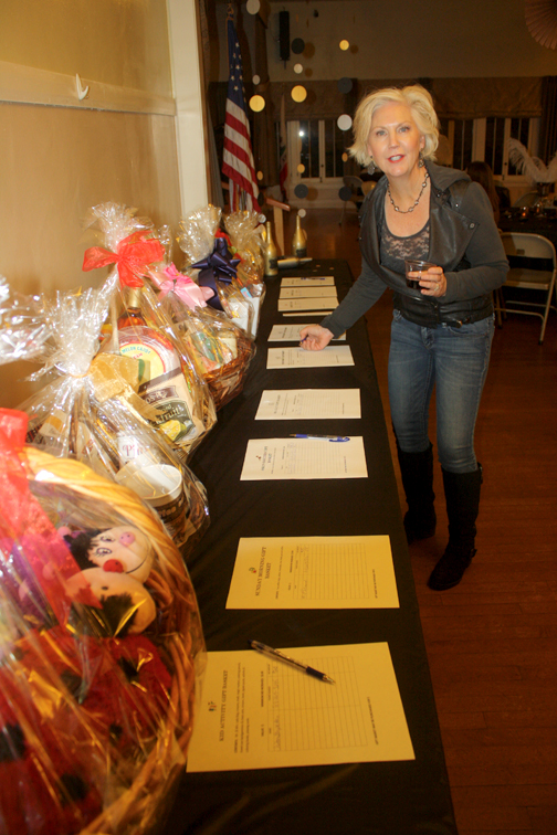 Former CVTC president Robbyn Battles bids on an item in the silent auction.