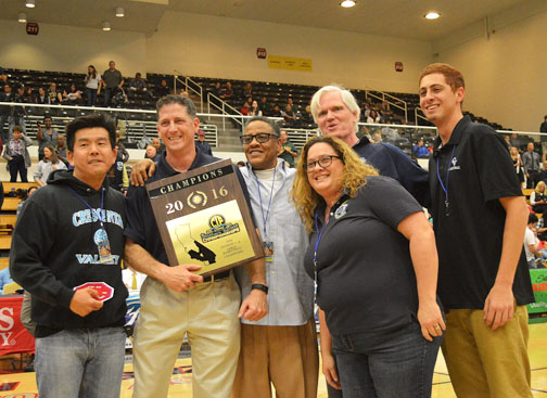 Coach Jason Perez (holding plaque) was confident in his team's strong defense.