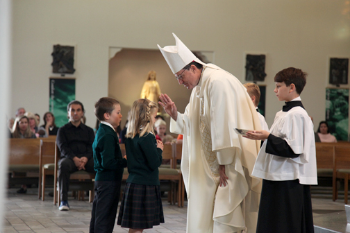 Bishop Joseph Brennan blessed students presenting the gifts during the school blessing Mass on Tuesday.