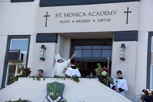 :  Bishop Joseph Brennan blesses St. Monica Academy's new campus and consecrates it to the Sacred Heart of Jesus on Tuesday.