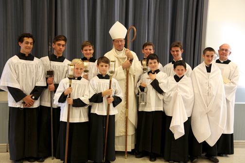 Bishop Joseph Brennan with St. Monica Academy altar servers. Back row (from left) are Eamonn Mireles, Liam Norton, Steven Conaway, Bishop Joseph V. Brennan, James Christian, Michael Grumbine, Deacon Bob Seidler. Front row (from left) are  Jude Halpin, Benjamin Perez, Calvin Cosgrove, Erik McNicoll, Clement Decker.