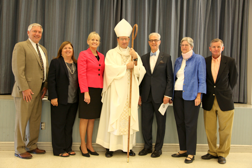 St. Monica Academy Board of Directors from left are President Martin Boles, Dan Murphy Foundation Executive Director Debra Kay Duncan, St. Monica Academy Headmaster Marguerite Grimm, Bishop Joseph V. Brennan, Dan Murphy Foundation Board member Richard Grant and his wife Maria Grant, St. Monica Academy Board of Directors member and Site Committee Chair Len Golbranson.