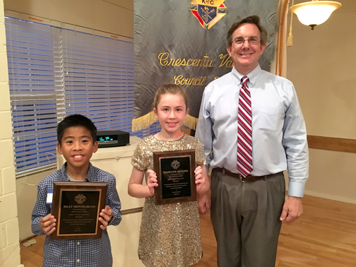 Photo provided by the Knights of Columbus Pictured are Riley Montelibano (left) and Madeline Higgins with Nick Doom, spelling bee organizer for the local Knights of Columbus council.