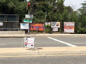 File photo Signs promoting everything from candidates to sports camps have sprung up throughout the unincorporated area of the county despite the town council working with the county to eliminate illegal signage.
