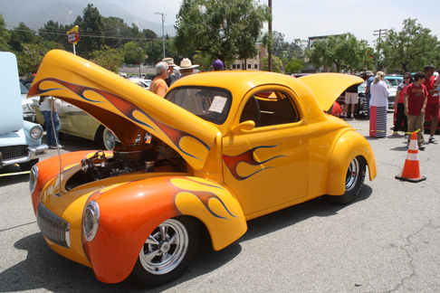 A 1941 Willys Coupe, painted bright yellow with red flames, attracted plenty of attention.