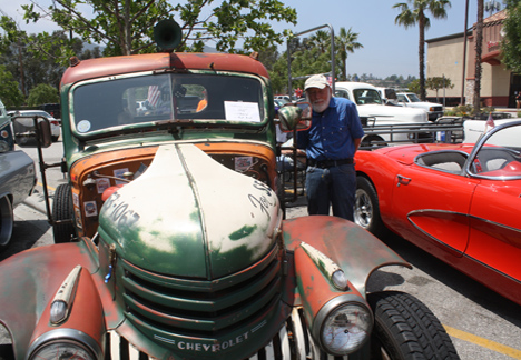 La Crescenta resident Jerry Burnham checks out a 1942 Chevy truck.