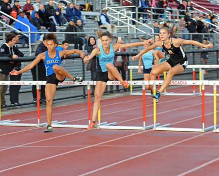 Falcon lead hurdler Liz Filipian ran a close race to win the 100H (15.4) with Burbank's Juliana La France taking second (15.6) and Christina Read of Arcadia placing third (15.6). Photos by Leonard COUTIN