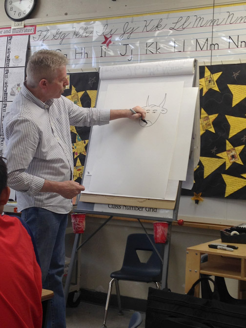 Author/Illustrator Tim Egan drawing for second graders.