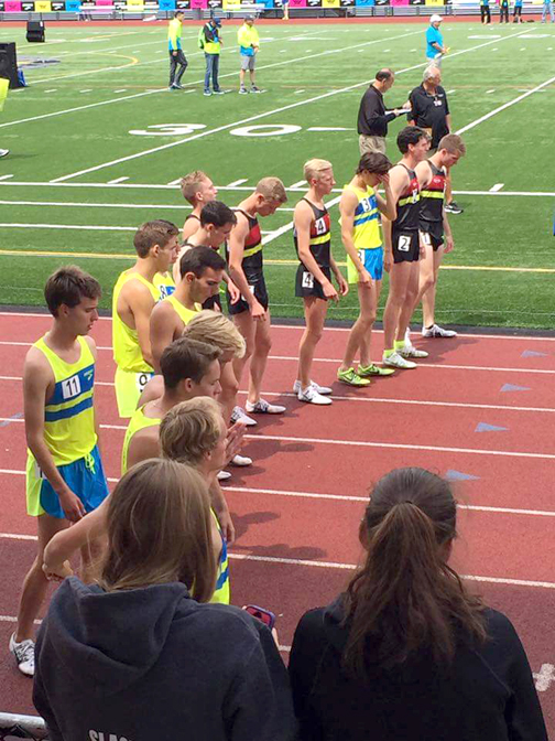 Jack Van Scoter, No. 11 (far left), waits for his two-mile start at the Brooks PR Invitational Meet.