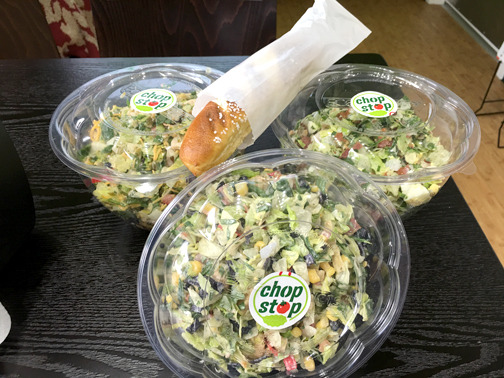 Salads are served in to-go bowls