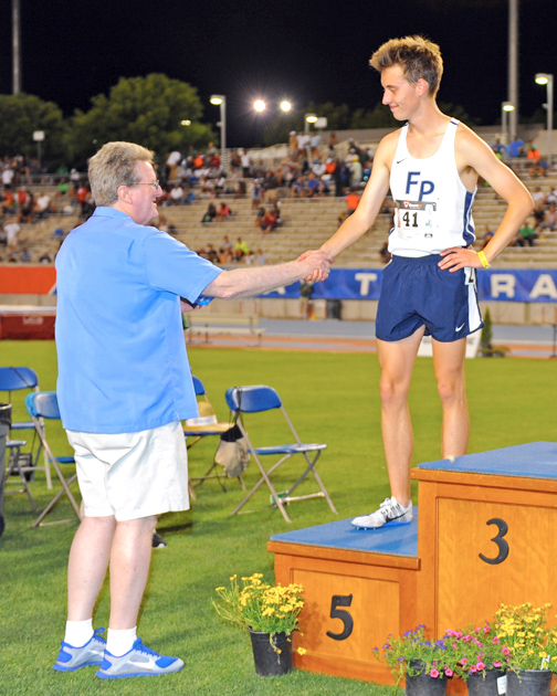 Jack Van Scoter of Flintridge Prep takes his place on the podium to receive his medal for fifth place in the 3200m at the CIF State Track and Field Championships.
