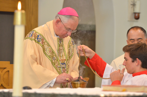 Photo provided by St. Monica Academy Archbishop Jose Gomez fills the thurible with incense during the baccalaureate Mass.