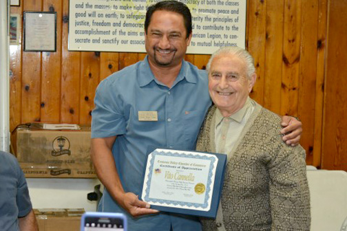 Kaipo Chock of the CV Chamber of Commerce presents Cannella with a certificate of appreciation during the breakfast.