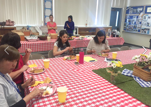 Teachers and staff enjoying a delicious luncheon provided by VV PTA