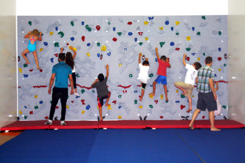 A climbing wall for kids has been installed in the aerial room.