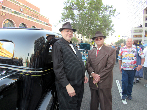 Photos by Mary O'KEEFE Ken Sobel (left) and Larry LeVine, dressed in period garb, stand next to Sobel's 1934 Dodge DRXX.