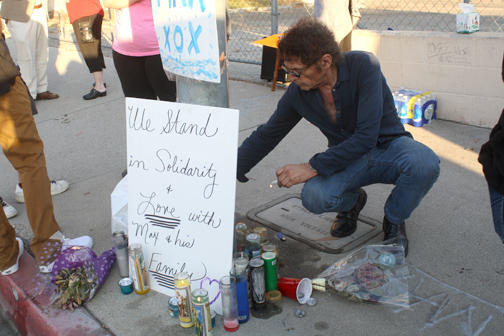 A supporter lights a candle at the vigil.