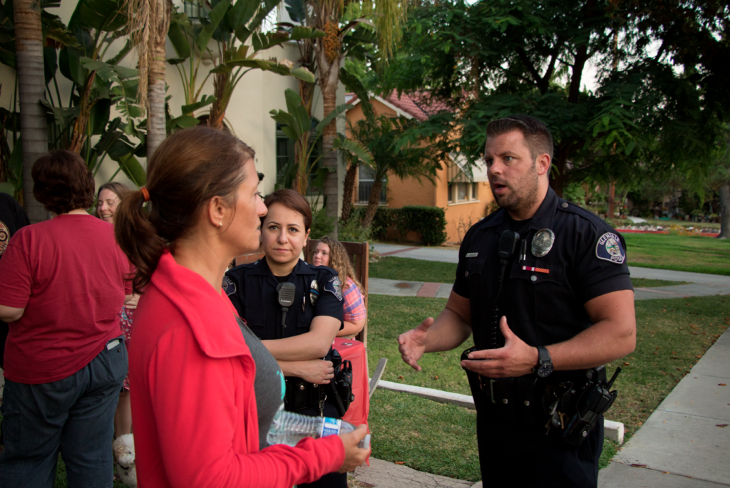Photo by Nick ZAMORA Community members visited with Glendale police officers during several NNO events held throughout the valley.