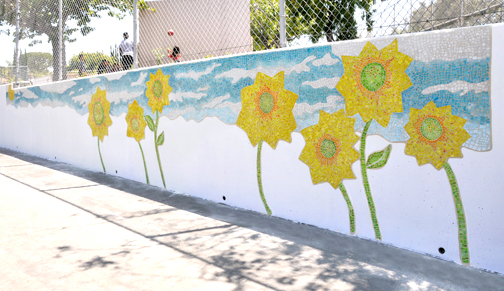 "Sunflowers adorn the campus of Sunland Elementary School after an art project by Hannah Maximova titled ""Every Bloom a Star"" was installed."