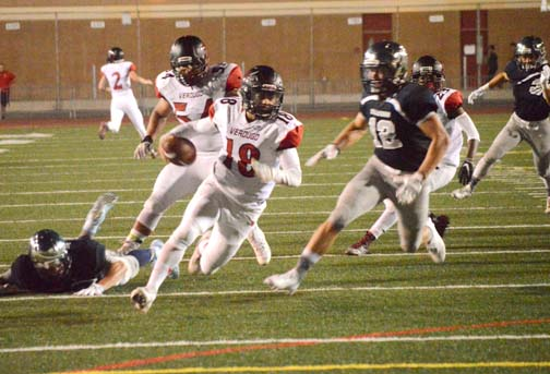 Dons' quarterback Mason Van Kempen was hassled all night by a swarming Falcons' defense.