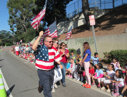 dr-reynolds-with-teachers-wave-the-flag-as-students-cheer-at-valley-view-web
