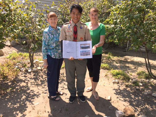 The La Crescenta Woman's Club, represented by incoming president and History Dept. curator Marianne Jennings (right), with longtime member and Past President Deanna Alfeld discuss with Kevin Tom where the bench will be constructed.