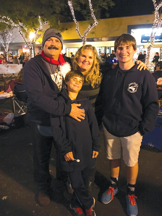 Photo provided by Elze Family From left are Brad, Lukas, Kristen and Hayden Elze at the Montrose Christmas Parade. A gofundme page has been set up for the family after Brad's untimely death.