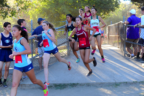 Coming off the bridge at CV Park, the Saugus girls were in the lead. The two top positions were secured by Saugus runners Mariah Castillo (18:08.53) and teammate Kaylee Thompson (18:23.18).