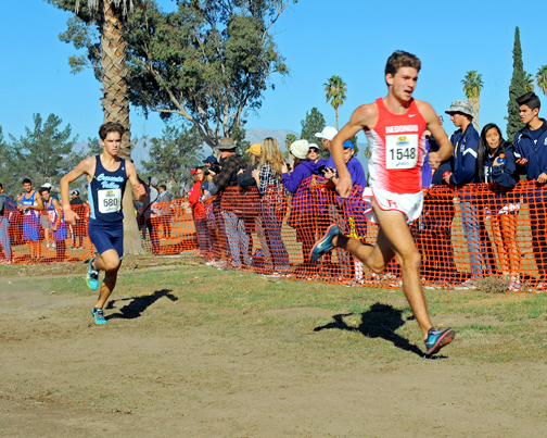Photos by Leonard COUTIN Colin FitzGerald (No. 580) making his final attempt to overcome lead runner Ethan Comeaux (No. 1548) from Redondo Union at the completion of the CIF Division 1 championship CIF race.