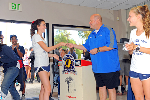 Flintridge Prep athlete Natalie O'Brien shown receiving her CIF award by Southern Section Commissioner Rob Wigod.