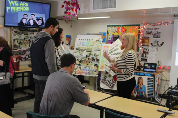 File photo Virginia Benzer, a teacher at Clark Magnet High School (shown here at the 2015 open house), visits with some prospective students during the school's annual event.
