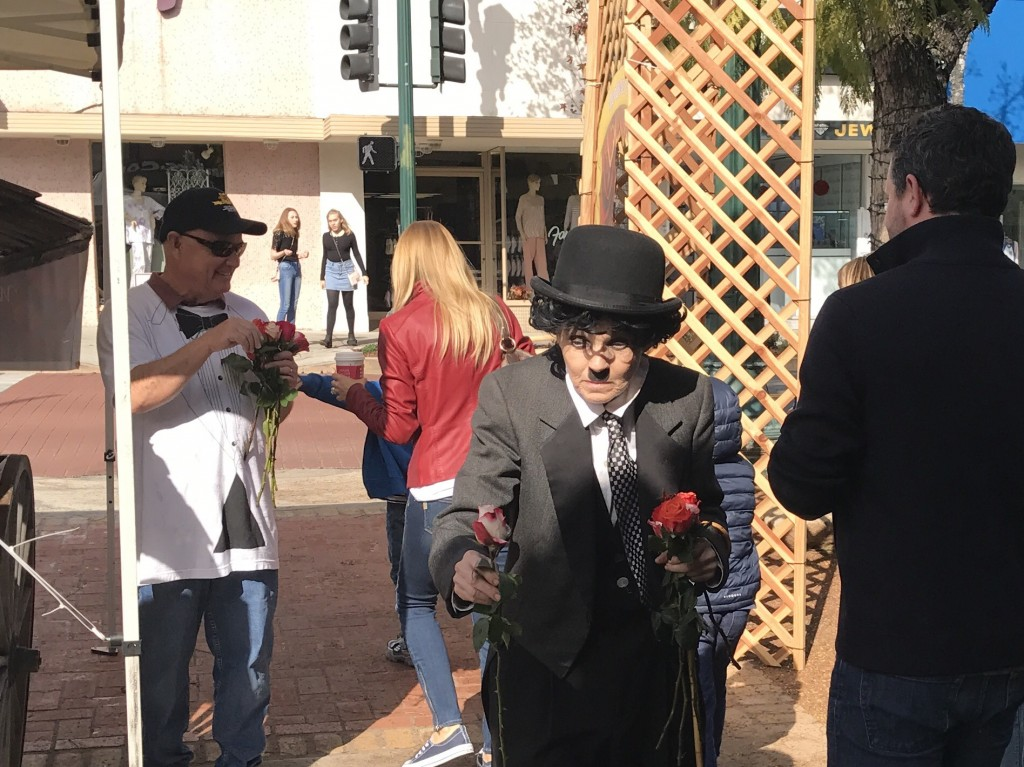 Charlie Chaplin impersonator Audrey Ruttan, handed out roses to all the ladies shopping and dining in the popular shopping park.